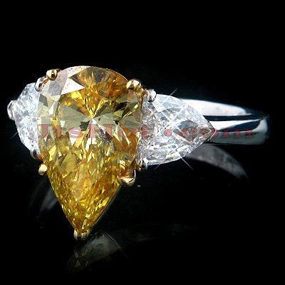 Unique Bullet & Fancy Vivid Yellow Pear Shaped Diamond Ring in Platinum